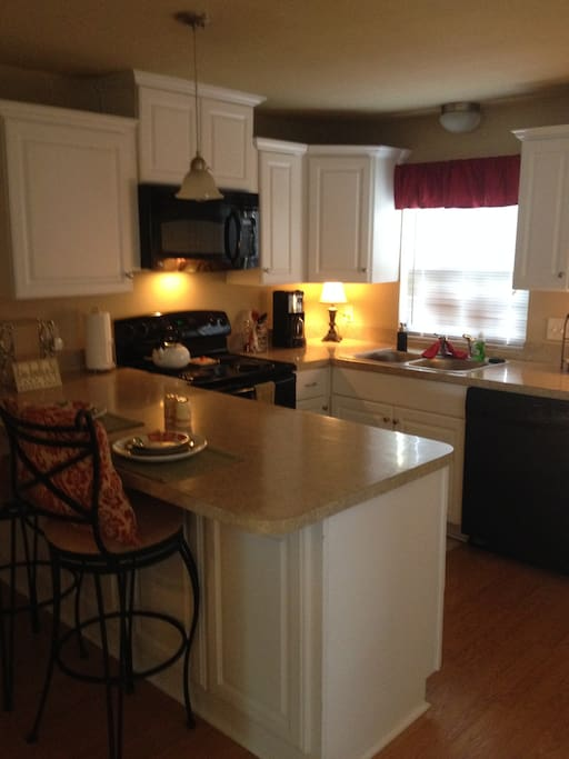 Full kitchen with fridge, stove, Microwave and dishwasher.