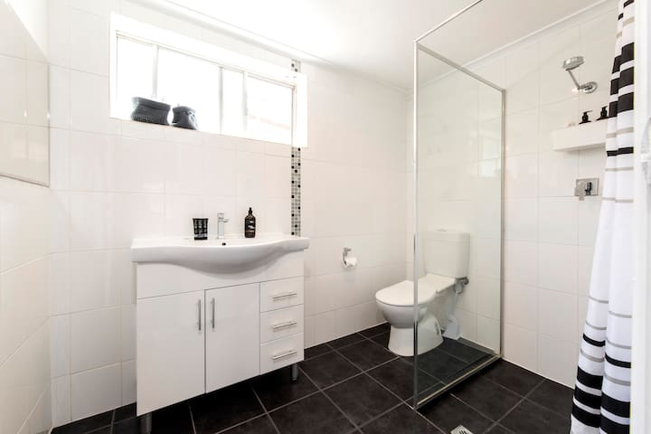 Ensuite bathroom with plenty of complimentary toiletries