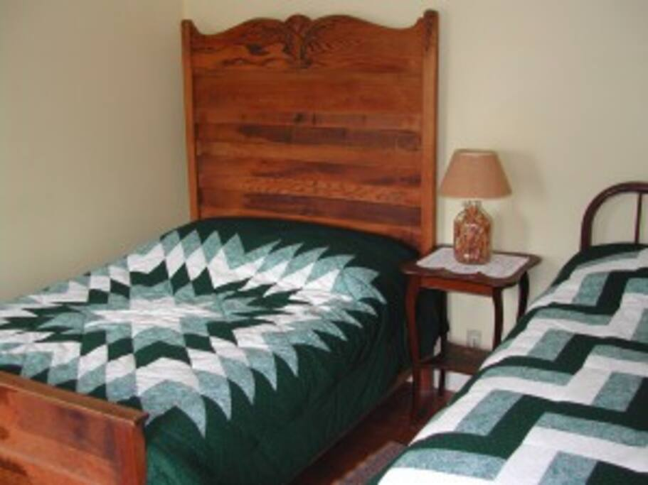 Kathleen's handmade quilts on every bed.