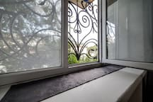 Windows with ornamented window grills