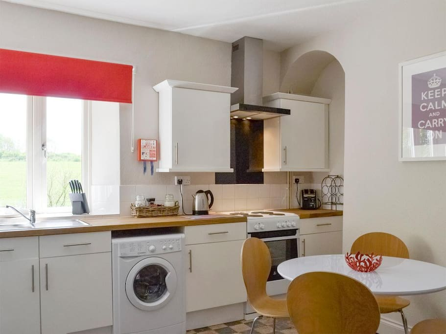 The sociable kitchen has views across the garden and paddocks.