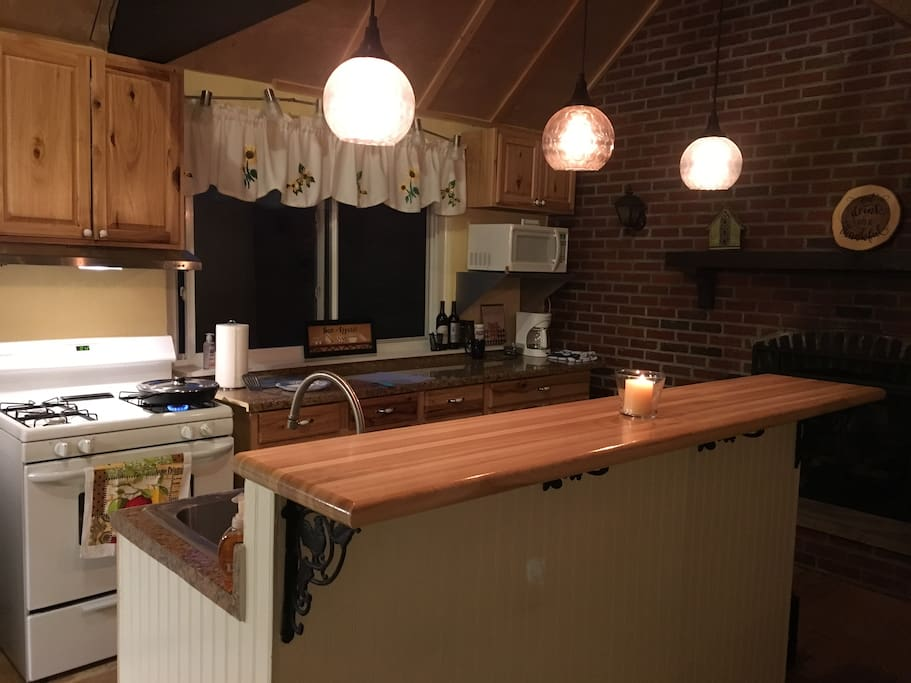 County kitchen overlooking wooded lot
