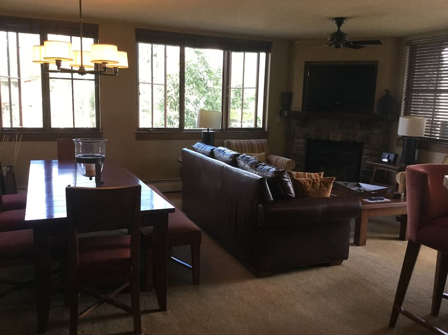 Living/dining room with balcony and great views of Spud Mountain