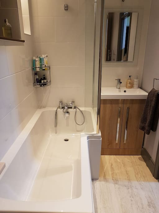 Bath with shower inside
