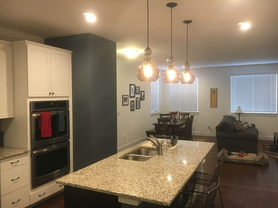 Kitchen, dining, and family room areas are shared spaces.