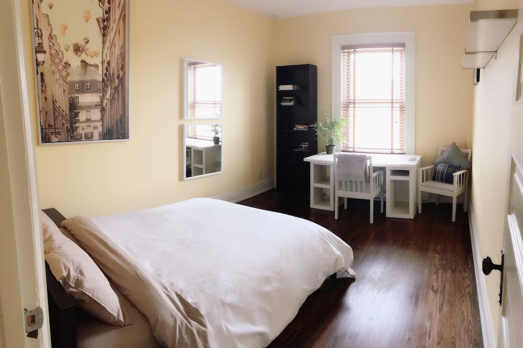 Sunny and spacious bedroom with study.