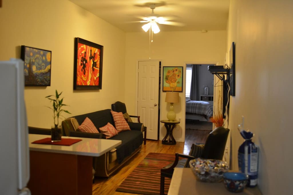 Living room with sleeper sofa, full closet, tv, cable, wifi, checker table, lamp, coffee table, chairs