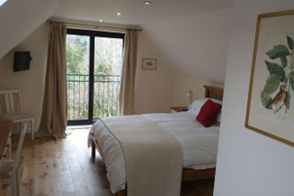 2nd floor bedroom with Juliette balcony overlooking River Doon