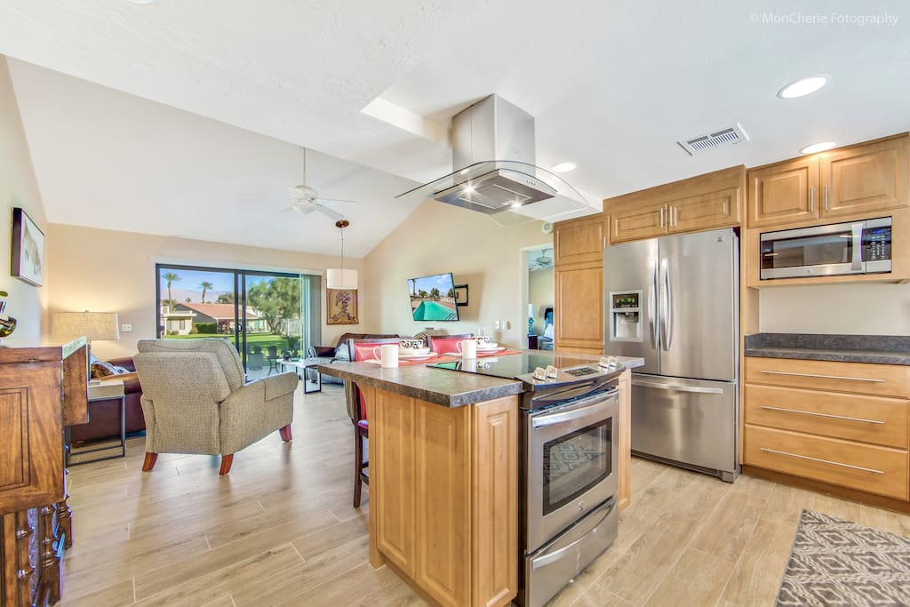 Open kitchen, living room, with view of greenbelt.