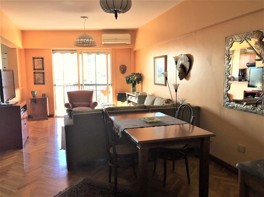 Living room/dining area (11'x23') opens onto balcony.  Artwork from Mexico, Italy, Malaysia, China, Indonesia set the tone.  Air conditioner for summer and gas heater for winter.