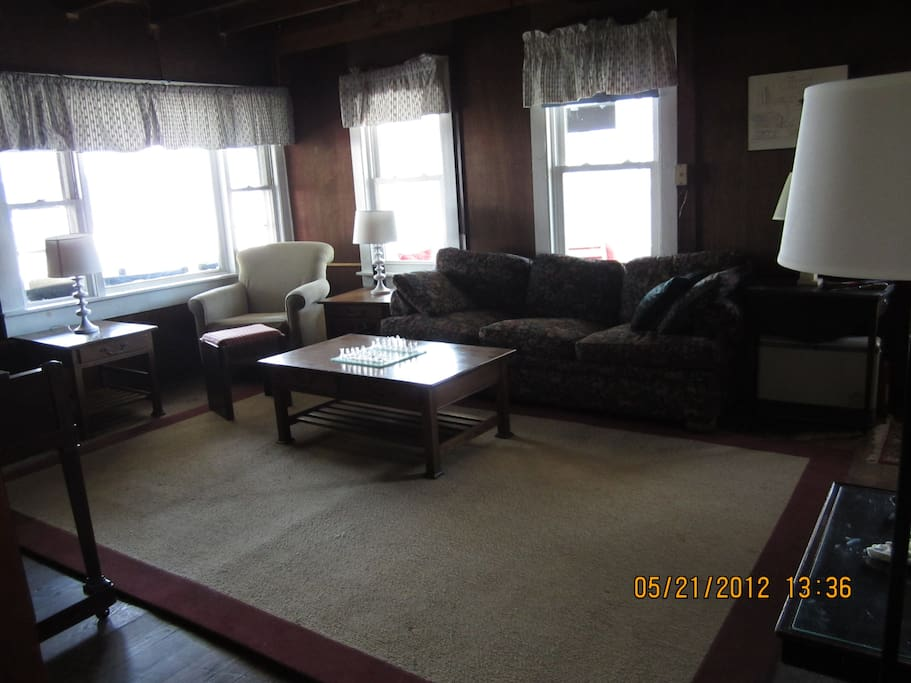 "LIVING ROOM WITH 46"" FLATSCREEN W/ DELUXE CABLE PACKAGE"
