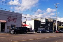 Building across from a lively main strip where there are local bars and very well known music venues