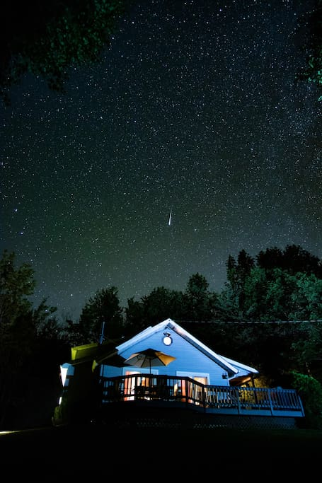 Shooting star over house at night