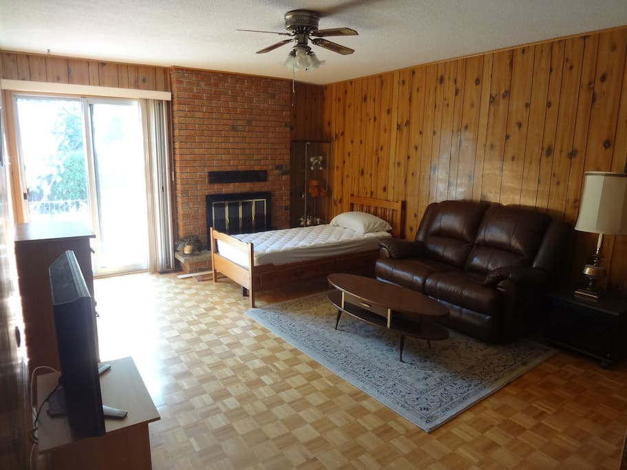 Living room with twin/single bed and direct access to backyard