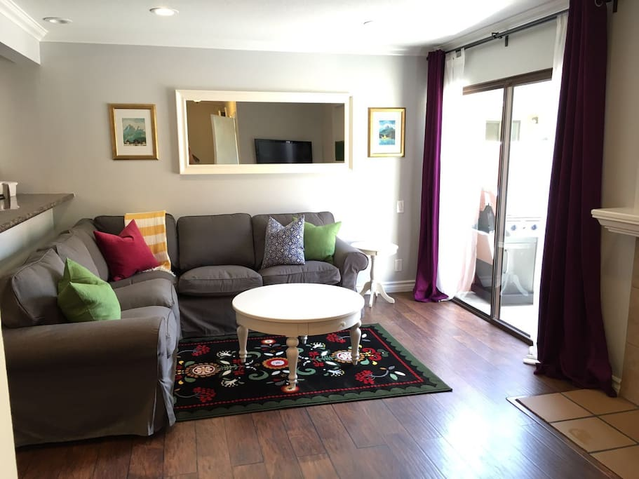 This comfortable living room has a large, comfy couch