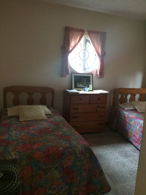 This is Your comfortable bedroom, 2 twin beds, chest with drawers, closet and a night table.
