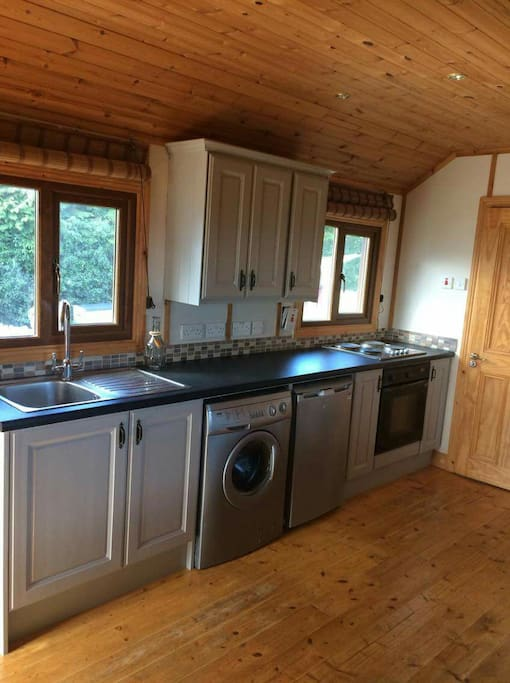 Kitchen complete with oven and hob washing machine and fridge frezer. Kettle and toaster also (not shown in photo)
