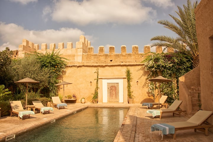 Riad with pool, staff, and garden with views