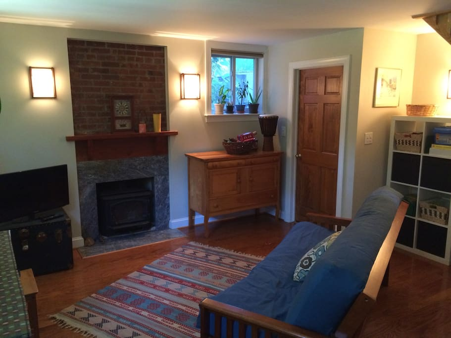 Den has a TV and a woodstove.