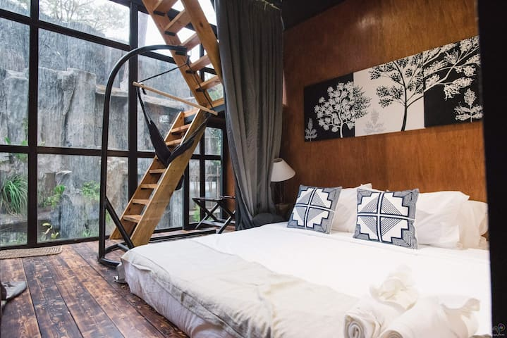 This is the Pine Cone Lower Deck Bedroom. You can see the waterfalls on your window