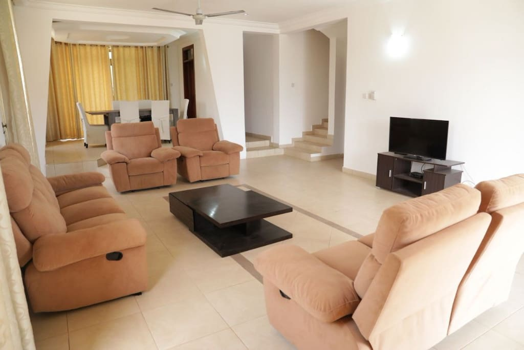 Very open and spacious living and dining area with TV and contemporary draperies