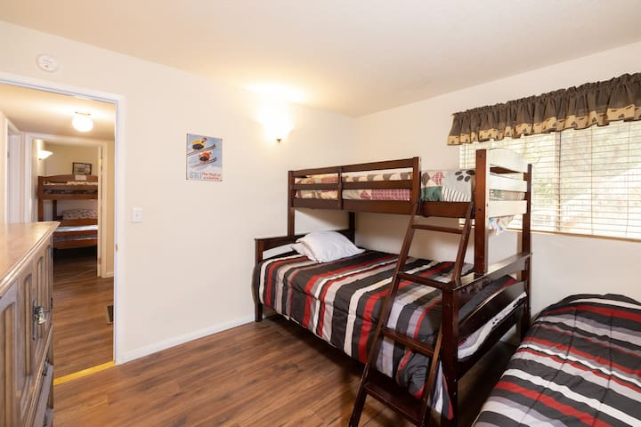 Downstairs bedroom with Full bed, and two Twin beds. Lamp with USB ports for easy phone charging.