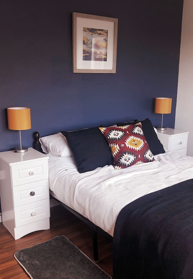 The newly refurbished bedroom  makes for a calming and relaxing space.