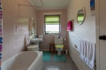Big, warm family bathroom will be totally renovated in 2018; bath to be replaced by a large walk in shower, and grab bars added in the shower and beside the toilet.