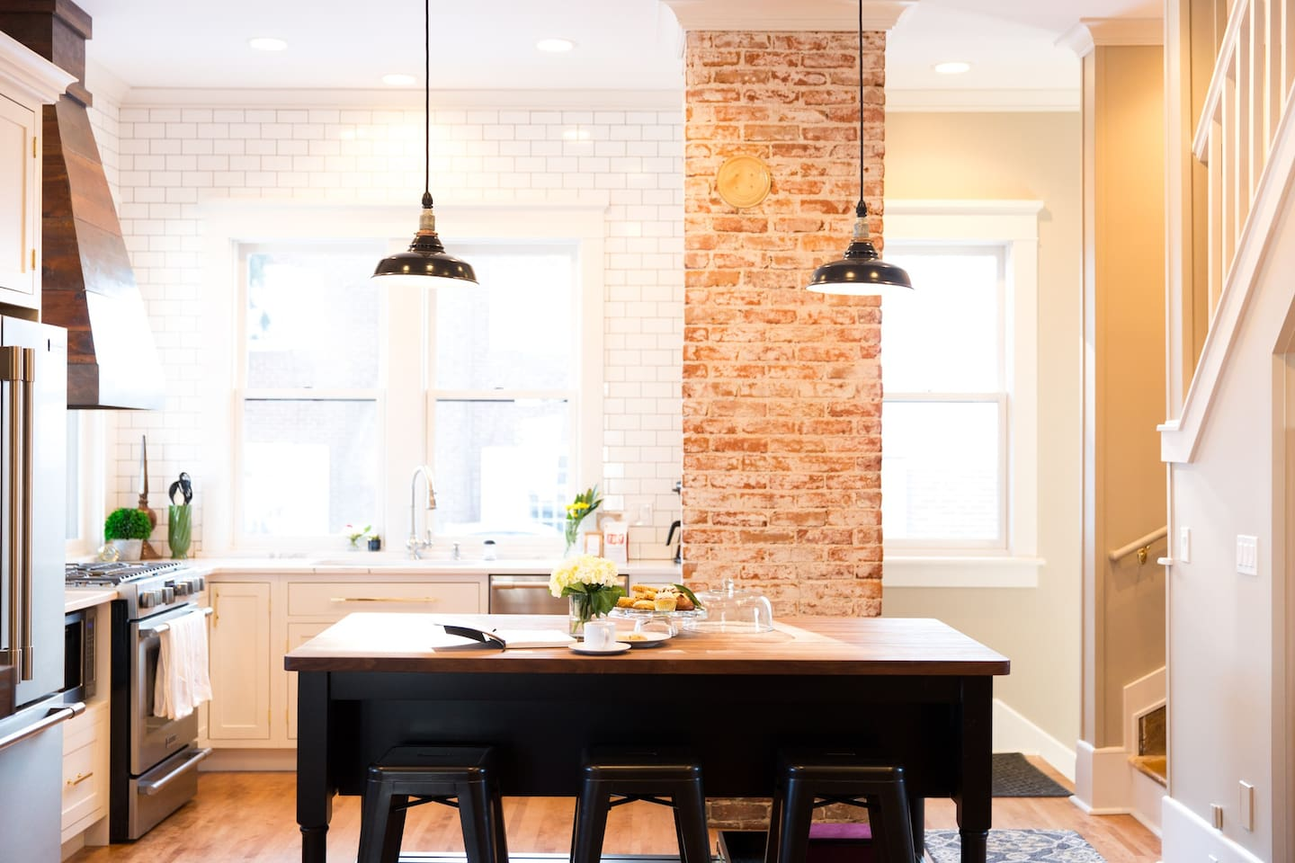 Bright and inviting kitchen with original chimney.