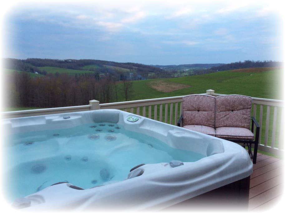 hot tub on deck overlooking the country side..this is built from the second bedroom and no one else can enter from the outside