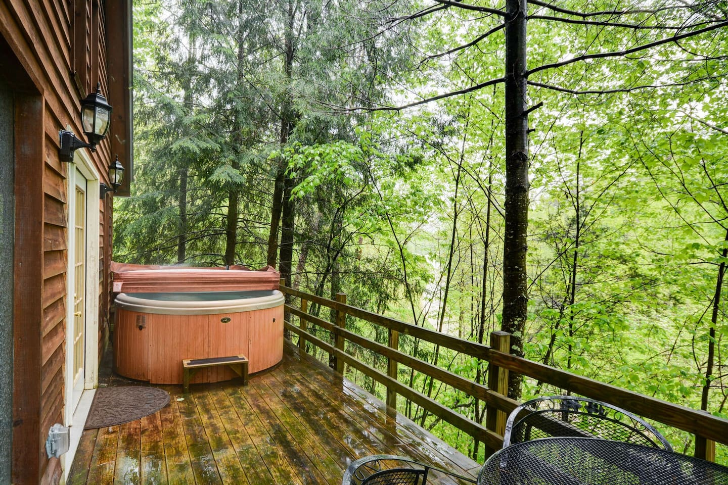 The back porch of Hidden Chalet is tucked away to provide you with privacy and beautiful nature views