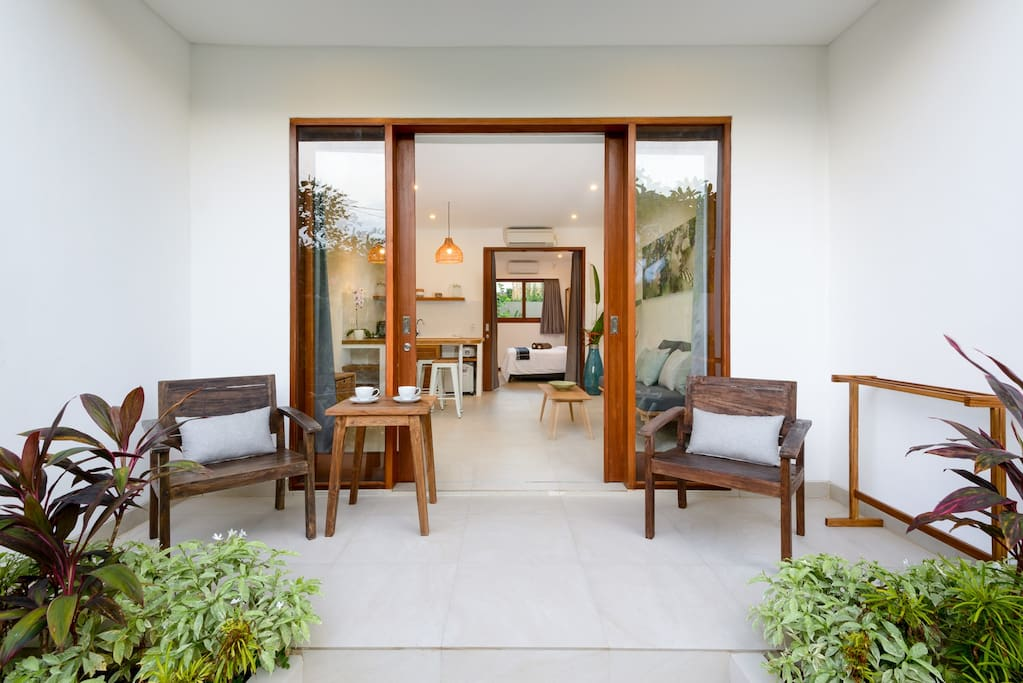 Enter through the large terrace with access to the pool