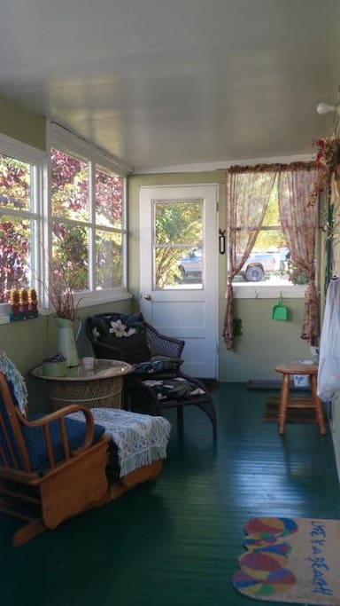 3 season sunroom with glider rockers for morning coffee or reading a good book..