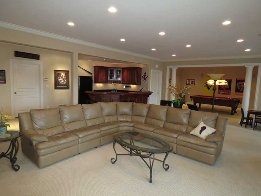 Basement has lots of space and is great for movies, billiards, or bar fun.