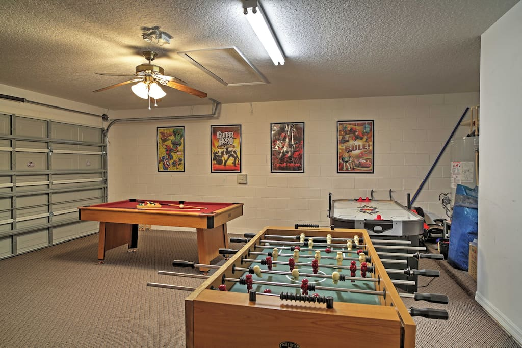 The garage has been converted into a fun-filled game room. Rack up the pool table or challenge your companions to a game of air hockey.