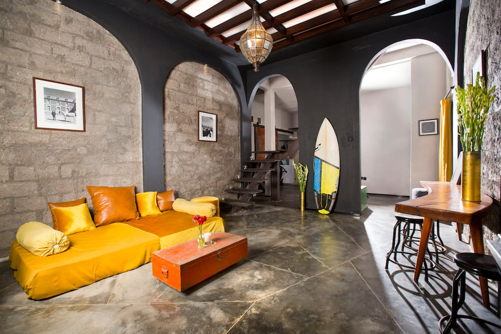 Spacious lounge features exposed brick walls, cool lighting, contemporary concrete floors and unique acrylic ceiling