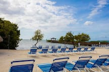 Unwind and relax on the private, oceanfront beach, complete with grills, picnic hut and lounge chairs, as well as sand volleyball.