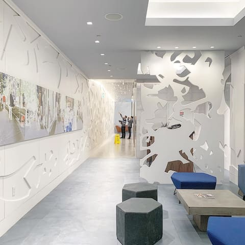 Corridor detailed with an Exquisite Techno and Retro Feel with the Interior and Exterior Building Decor influenced by internationally renowned artist, Michele Oka Doner.