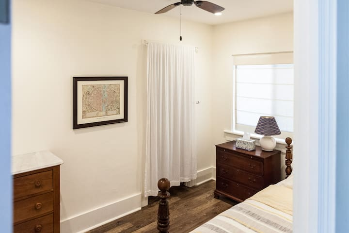 Back bedroom with closet and ceiling fan.