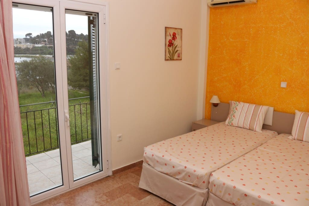The bedrooms are spacious, light and airy with a stunning view of Corfu town!
