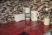 kitchen detail, toaster, coffee maker, kettle