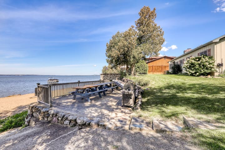 Quaint lakefront home w/ a large yard, sandy shores, only minutes to town!