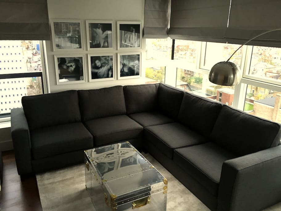 Lounge with extra large corner sofa and widescreen TV