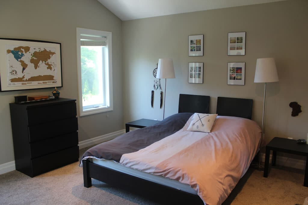 The spacious master bedroom, equipped with a queen-sized bed, has vaulted ceilings and lots of natural sunlight.