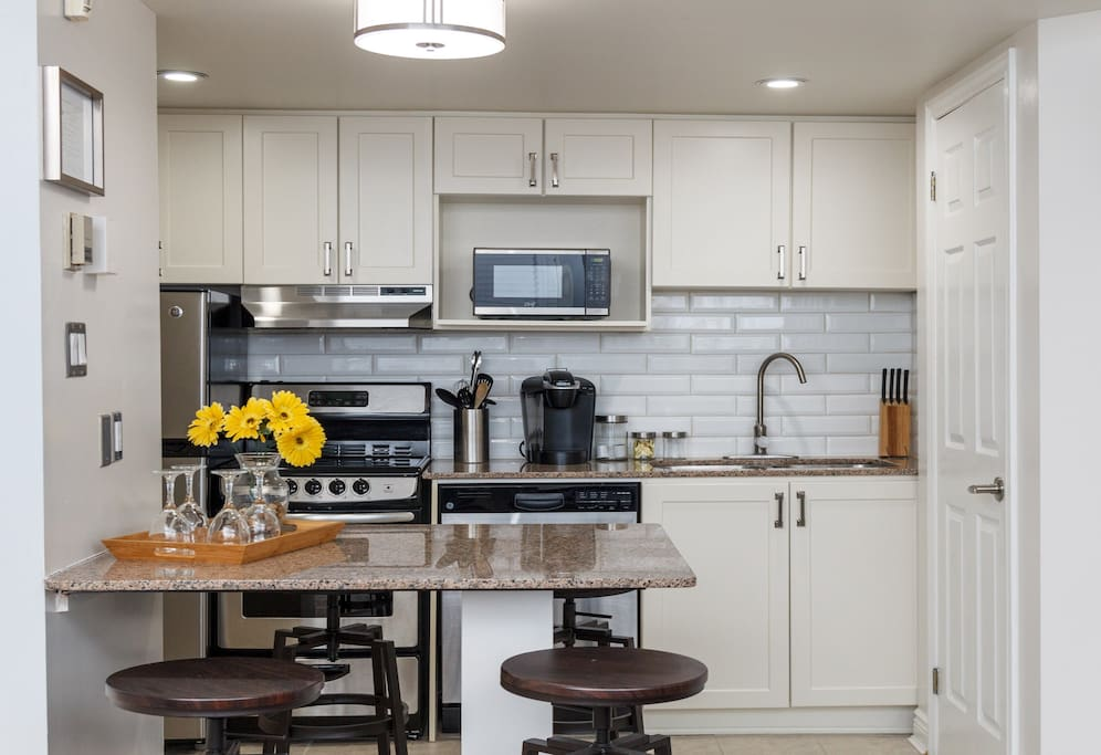 Enjoying cooking a meal in our full modern kitchen, which includes dishes, cutlery and all needed cooking utensils.  With many features like our Keurig coffee maker.