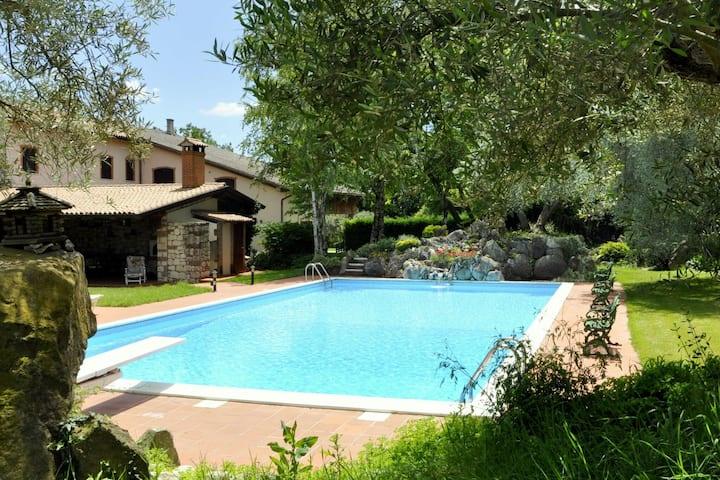 Quiet rustic farmhouse, surrounded by greenery, swimming pool with tennis court