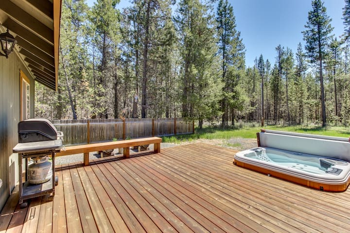 Enjoy a private hot tub & modern comforts at this dog-friendly Sunriver getaway!
