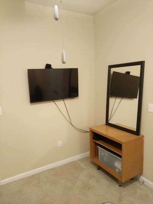 LED TV in bedroom with Apple TV access