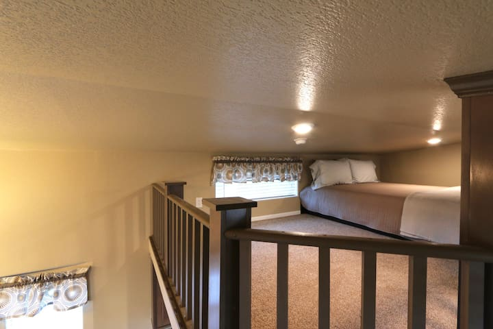 Loft with a queen size bed. Please be aware the loft has a 5ft ceiling.