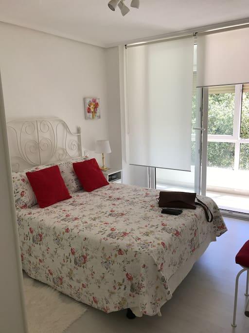 Dormitorio Principal con terraza y TV